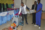 Director General of WDA Jerome Gasana handing over the start up kits to one of the trainees as the Assistant Director under 'Belgian Common TVET Support Program' (PAFP) ,Gideon Rudahunga looks on.